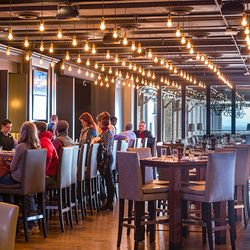 photo of people sitting at the bar in the Edison restaurant in the Grove Park Inn