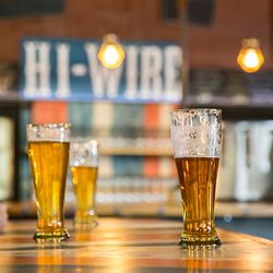 photo of pints of Hi-Wire Lager at their Big Top location in Biltmore Village
