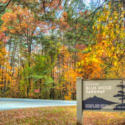 photo of fall colors behind Blue Ridge Parkway sign in fall