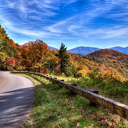 photo along the Blue Ridge Parkway in fall with mountain ridges in background