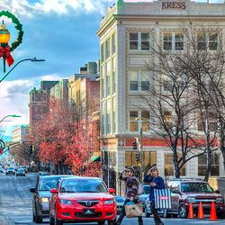 photo looking toward Asheville's Kress Building with holiday wreath on lightpost