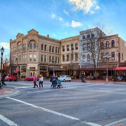 photo of people crossing street at the top of Biltmore Avenue in downtown Asheville