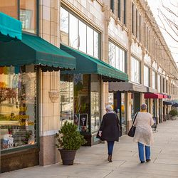 photo of shoppers in front of the Grove Arcade in downtown Asheville NC