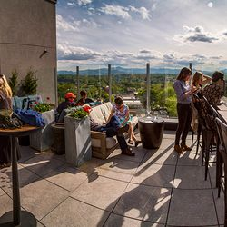 Photo of People Enjoying the Stunning Views at a Local Asheville Rooftop Bar