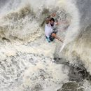 Brazil's Ferreira claims Olympic surfing's first gold