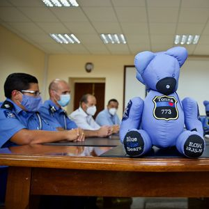 Photos: Son of Police officer receives soft toy in memory of his dad
