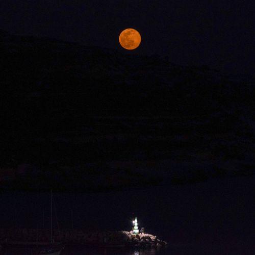 February's rising full moon