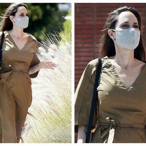 Анџелина Џоли носи сафари фустан што визуелно додава облини