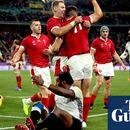 Wales survive major Fiji scare as Josh Adams hat-tricks seals top spot