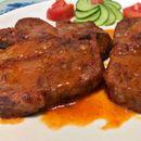 Свинско динстано месо во сос од бело вино и домати