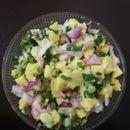 Салата со варени компири и младо кромитче