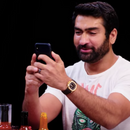 Kumail Nanjiani eats wings with a fork and knife on a very sweaty 'Hot Ones'