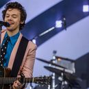 Harry Styles is going to read us a bedtime story and it's exactly what we need right now