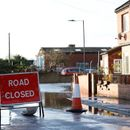 Residents told to leave homes as downpours bring floods across northern England