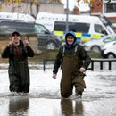 Woman dies as downpours bring floods across central and northern England