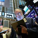 Wall Street opens higher as trade worries ease
