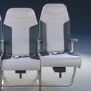 Company aims to make flying 'less miserable' with roomier design for middle seat, two-level armrests