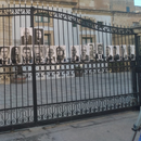 Repubblika protest in front of police headquarters carrying pictures of 'criminals in command'