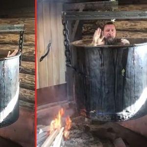 """Руски тајкун запалил оган, седнал во голем котел па пратил порака: """"Вака се лечат разни болести"""""""