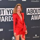 Doutzen Kroes shows off her famous pins in a tiny frock at an awards bash in Germany