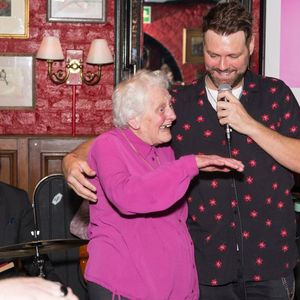 Brian McFadden duets with an elderly fan and makes her day during low-key gig in London