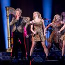 Rod Stewart belts out his classics beside blonde stunners in tight animal print on opening night of tour