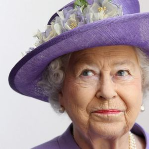 The Queen jokes she always wears bright colours because 'if I wore beige, nobody would know who I am'