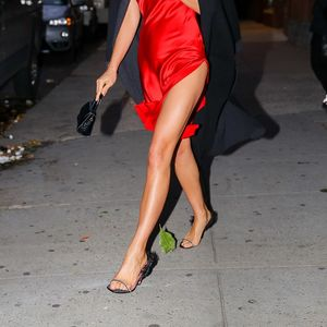Irina Shayk flaunts her legs in a crimson dress in New York after split from Bradley Cooper