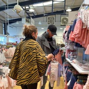 Jeremy McConnell is the doting dad as he shops for baby clothes with girlfriend Katie ahead of birth of daughter