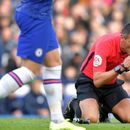 Watch Chelsea ref Andre Marriner get knocked down by ball in the face… before bowing to fans