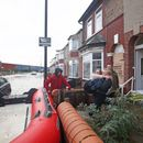 UK floods: Hundreds of families trapped in their homes are rescued by boats as 'biblical' rain wreaks havoc