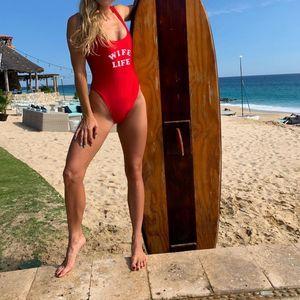 Tennis beauty Caroline Wozniacki stuns in Baywatch-style bikini in beach photoshoot