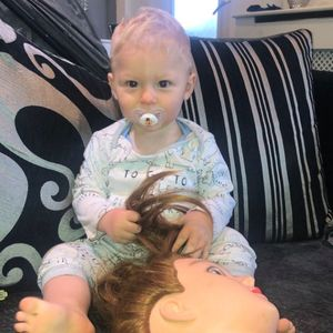 Mum let her son play with her hair to get to sleep – but now he takes a creepy mannequin head everywhere