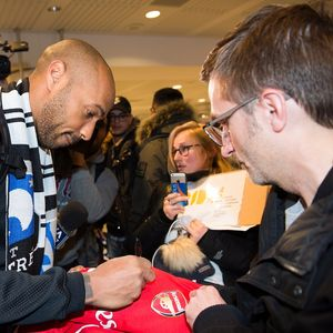 Thierry Henry hugs fans and poses for selfies at Montreal airport as Arsenal legend arrives in Canada for manager job