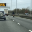 Reckless biker stands up on his seat while speeding on busy London motorway