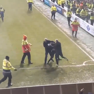 Watch shocking scenes as rival Blackpool and Fleetwood fans fight on the pitch in the League One clash