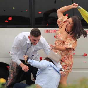 Mass brawl breaks out at races as girl batters man with bunch of flowers in Sydney
