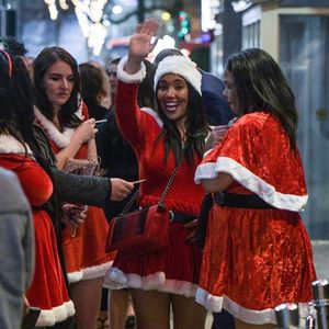 Brits get into the festive spirits as they hit the town for boozy Christmas parties across the country