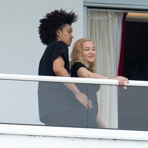 Madonna, 61, gets close with 'boyfriend' Ahlamalik Williams, 26, as they relax with her daughter, 23