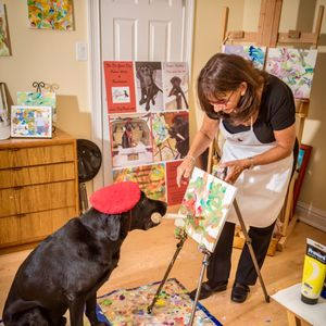 Labrador dubbed DogVinci has painted more than 650 masterpieces — and he's raised £150,000 for charity
