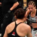 Incredible photo shows UFC fighter's face horrifically contort as she is kicked in the face
