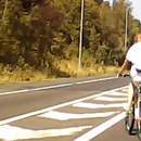 Shocking footage shows idiot cyclist ride across entire M60 motorway while dodging speeding cars