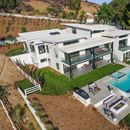Inside UFC legend Joe Rogan's luxury £4m mansion including wine cellar and pool with picturesque views of hills