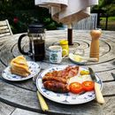 Piers Morgan's mum cooks him a fry up as they reunite at his Sussex mansion after 114 days apart