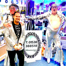 Coronation Street's Simon Gregson is unrecognisable as he wears silver catsuit and floral dress to help at mate's shop