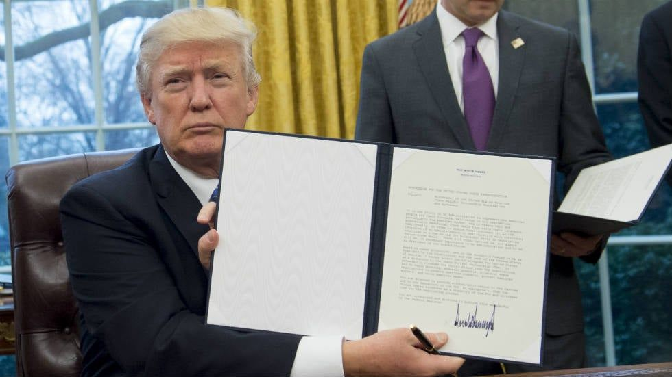Trump signs executive actions on TPP, abortion, federal hiring freeze