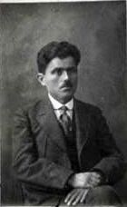 Photograph of a seated Pontic Greek man in a suit.