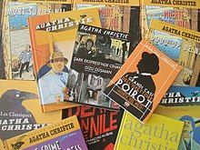 Colour photograph of numerous books showing illustrated front covers with titles in many languages