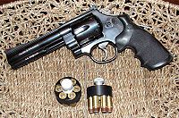 A revolver in a wicker basket with two lock cylinders next to it