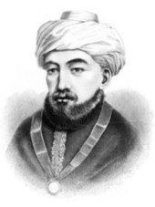 Black-and-white portrait of a bearded man with turban